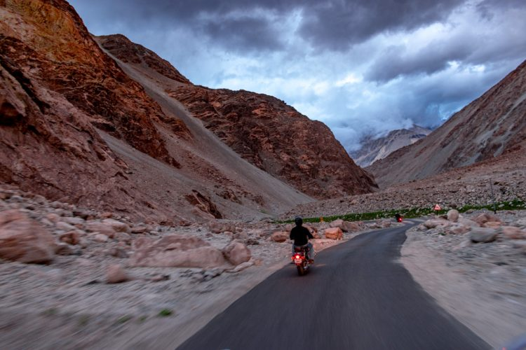 Motorcycle riding on mountain roads through the hills of Ladakh