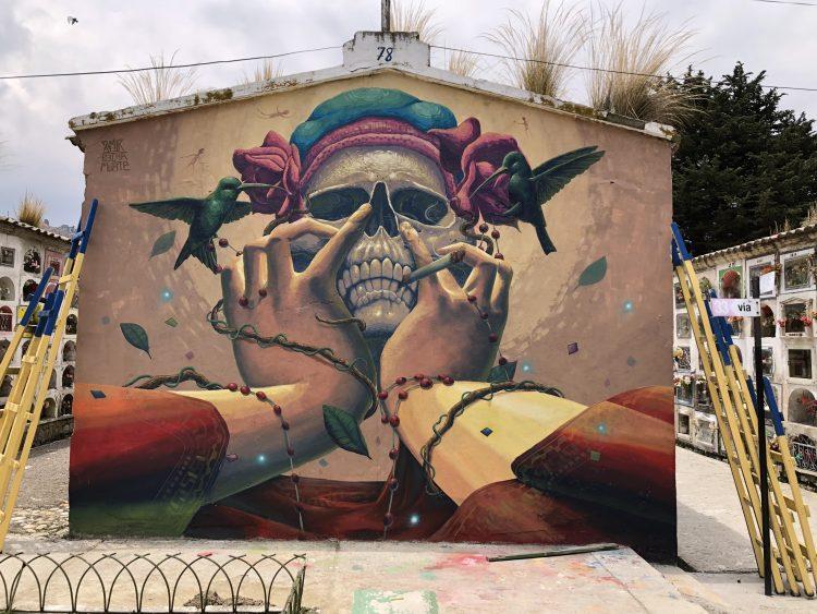 Street Art in La Paz: Hands grabbing skull -