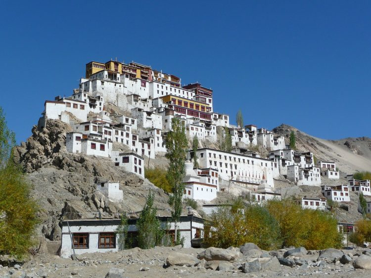 White houses and monastery on hill in Ladakh, India