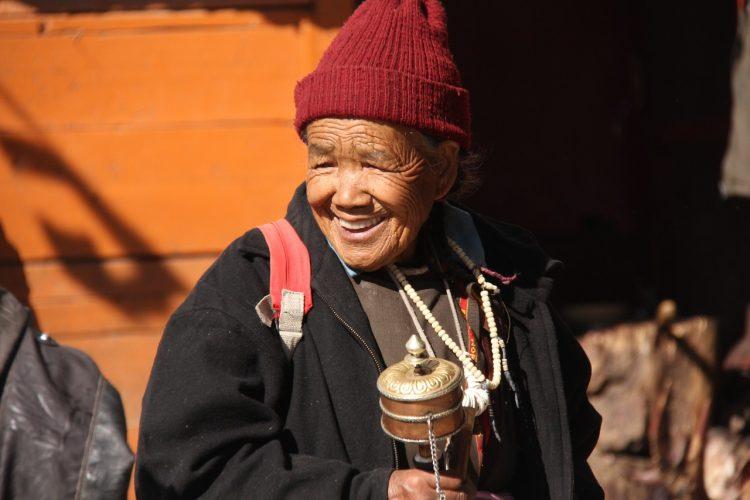 Ladakhi Woman with Buddhist prayer wheel