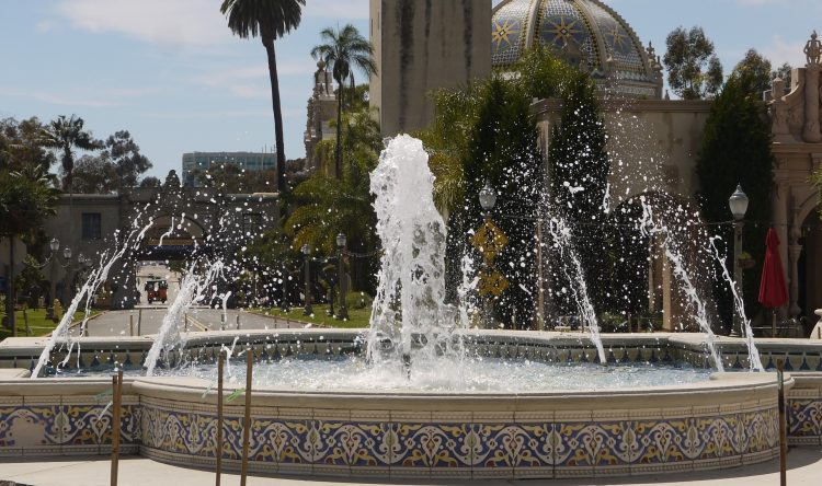 Beautiful fountain on a sunny day in Balboa Park with the cathedral in the back