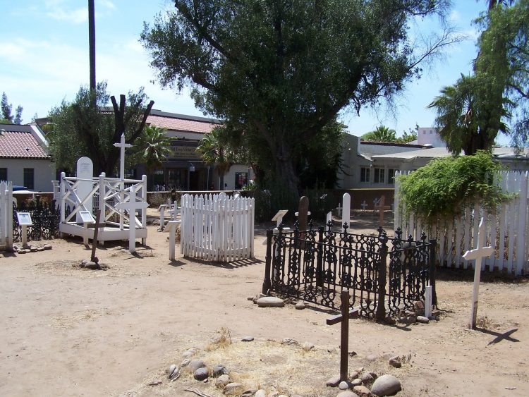 Empty old graveyard in the burning daylight with trees in Old Town San Diego
