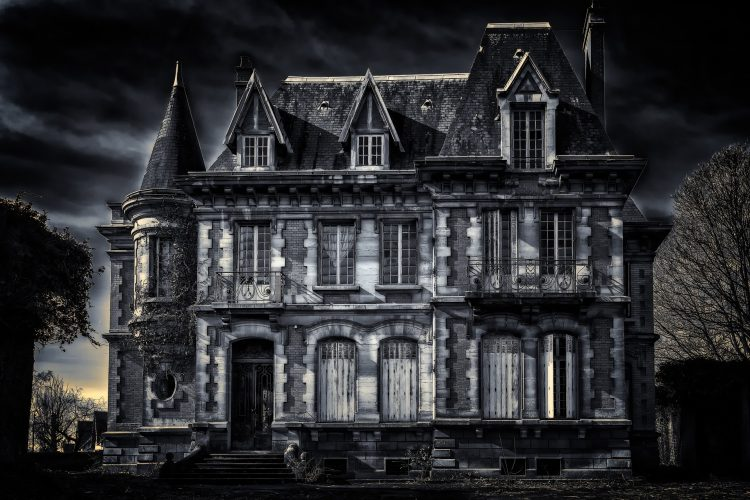Spooky ominous mansion in the middle of nowhere on a dark and stormy night